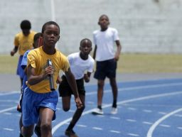 This student from Pentecostal Light and Life Primary is focused as he tries to catch the leaders on the anchor leg during in the Boys U-9 4x100M race.