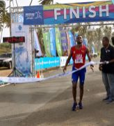 Marathon winner Richer Perez Cobas of Cuba crosses the finish line.