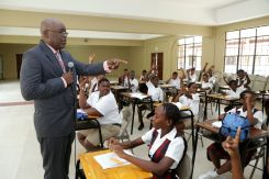 Chief Secretary Kelvin Charles shares some advice with students of the Pentecostal Light and Life Ministries Primary School.