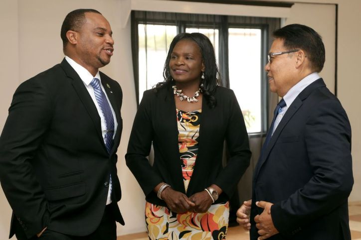Secretary of Infrastructure, Quarries and the Environment Councillor Kwesi Des Vignes, left, chats with CCPA president Garvin Monzano, right, and vice president Shirley Cooke.