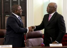 Chief Secretary Kelvin Charles, right, congratulates Secretary of Finance and the Economy and Deputy Chief Secretary Joel Jack after Jack presented Tobago's budget request at the Assembly Chamber.