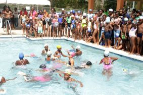 Standard One girls take part in a novelty race in the wading pool.