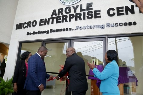 THA Chief Secretary Kelvin Charles, second from right, cuts the ribbon to open the Argyle Mice Enterprise Centre on Thursday afternoon. With him from left are Administrator in the Division of Community Development, Enterprise Development and Labour Cherryl-Ann Solomon, Secretary of Finance and the Economy Joel Jack and Secretary of Community Development, Enterprise Development and Labour Marslyn Melville-Jack.