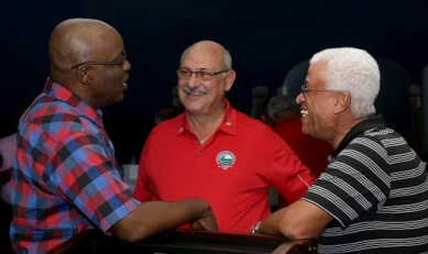 THA Chief Secretary Kelvin Charles, left, chats with tournament organiser Jeffrey Azar, centre and participant Neil Guisseppi.