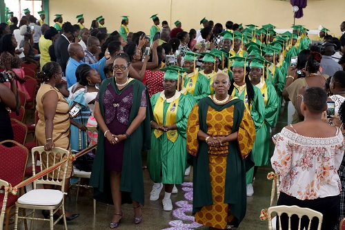 Signal Hill Secondary school principal Allyson Potts, right, and acting Vice-principal Wendy Baptiste-Henry lead the graduates into the assembly hall at the start of the ceremony.