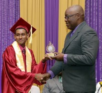 THA Chief Secretary Kelvin Charles presents Jared Clement with an award for his excellence in the study of Information Technology.