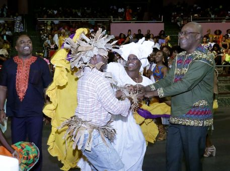 Chief Secretary Kelvin Charles, right, joins in as the festivities wrap up.
