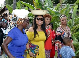 Minister of Tourism Shamfa Cudjoe, foreground, second from left, takes part in the festivities along with Minister in the Office of the Prime Minister Ayanna Webster-Roy, right, and Minister of Community Development, Culture and the Arts Nyan Gadsby-Dolly, second from right, as they stroll along the Northside Road.