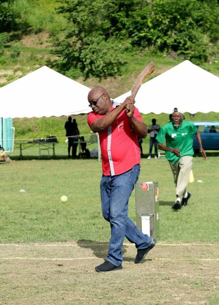 THA Chief Secretary Kelvin Charles bats with the stem of the branch from a gru gru tree to mark the start of the games.