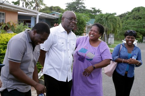 Assistant Secretary Sheldon Cusningham, left, enjoys the banter as the Chief Secretary is subjected to ardent supporter Carol Reid's picong as Avian Parks joins in the laugh.
