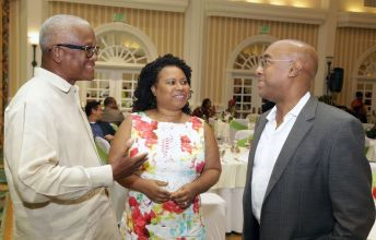 First Citizens chairman Anthony Smart, left, chats with Presiding Officer of the Tobago House of Assembly Dr Denise Tsoiafatt-Angus and the bank's deputy chairman Courtenay Williams.