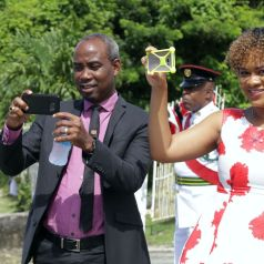 Member of Parliament for Tobago East and Minister in the Office of the Prime Minister Ayanna Webster-Roy, right, takes a photo as she looks on at the Parade.