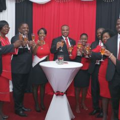 Minister in the Office of the Prime Minister Ayanna Webster-Roy, left, and Minister of Tourism Shamfa Cudjoe, right, toast with THA Secretaries following the Parade. The Secretaries are, from left, Clarence Jacob, Secretary of Settlements, Urban Renewal and the Public Utilities; Councillor Dr. Agatha Carrington, Secretary of Health, Wellness and Family Development; Joel Jack, Deputy Chief Secretary and Secretary of Finance and the Economy; Nadine Stewart-Phillips, Secretary of Tourism, Culture and Transportation; Kwesi Des Vignes, Secretary of Infrastructure, Quarries and the Environment; Marisha Osmond, Assistant Secretary in the Office of the Chief Secretary; Hayden Spencer, Secretary of Food Production, Forestry and Fisheries; Marslyn Melville-Jack, Secretary of Community Development, Enterprise Development and Labour; and Shomari Hector, Assistant Secretary of the Division of Community Development, Enterprise Development and Labour.