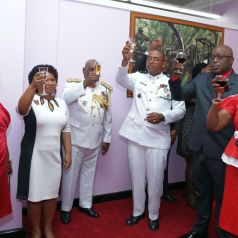 Chief Secretary Kelvin Charles and his wife Catherine, right, toast to Trinidad and Tobago's 55th Anniversary of Independence. Also in photo is Presiding Officer Denise Tsoiafatt-Angus, second from left.