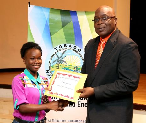 Chief Secretary Kelvin Charles presents Tania Alexis with a certificate of participation.