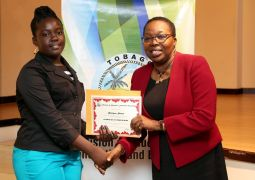 Shiniqua Skeete receives a certificate of completion from Assistant Education Coordinator for School Supervision, Claire Braithwaite Alexander.