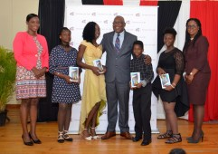 THA Chief Secretary Kelvin Charles poses for a photo with attendees at the awards ceremony.