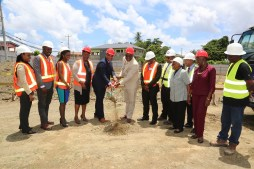 THA and Udecott representatives participate in the sod-turning ceremony in the village of Roxborough, including fourth from left, Infrastructure Administrator Jacqueline Job, Secretary for the Division of Infrastructure, Quarries and the Environment Kwesi Des Vignes, Chief Secretary Kelvin Charles and UDeCOTT CEO Frank Barnes.