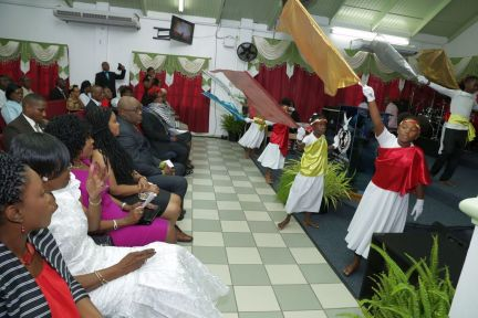 Children perform a dance during the anniversary service as guests look on, including Chief Secretary Kelvin Charles, centre front row, and Tobago West MP Shamfa Cudjoe, Minister of Tourism, as well as (from left) Assemblyman Marisha Osmond, area representative, Councillor Dr Agatha Carrington, Secretary for Health, Wellness and Family Development and Assemblyman Marslyn Melville-Jack, Secretary for Community Development, Enterprise Development and Labour.
