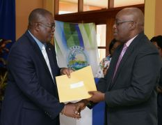 Michael Simmons receives his instrument of appointment from THA Chief Secretary Kelvin Charles.