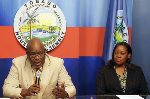 Chief Secretary Kelvin Charles addresses the new board. At right is acting Chief Administrator, Claire Davidson-Williams.