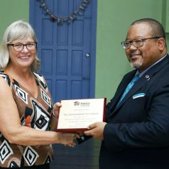 Canadian High Commissioner Carla Hogan-Rufelds, left, is presented with an appreciation award by chairman of the board of directors of Habitat for Humanity Trinidad and Tobago, Derwin Howell.