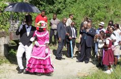 "This Moriah ""couple"", left, demonstrate the traditional Tobago wedding dance known as the brush back at Fairhill Trace, Moriah, where a mural was created to mark the end of the project. The Trace now also bears the name ""Canada Lane""."