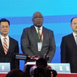 Deputy Governor of the People's Bank of China Chen Yulu, left, THA Chief Secretary Kelvin Charles, and Lu Pengqi, Vice Chairman of the China Council for the Promotion of International Trade (CCPIT).