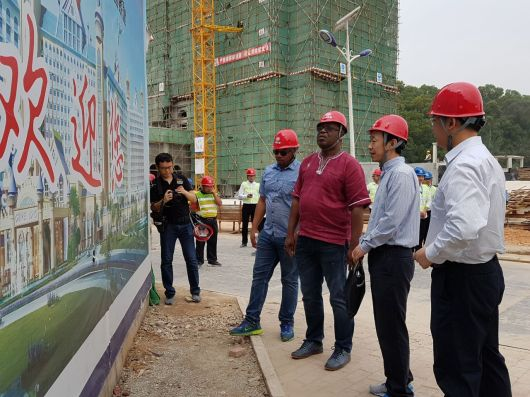 THA Chief Secretary Kelvin Charles and Secretary of Infrastructure, Quarries and the Environment, Kwesi Des Vignes are shown a design of the project by a team from the China Railway Construction Company (CRCC).