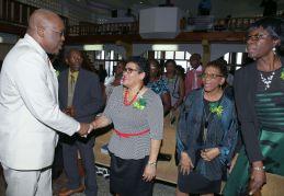 Chief Secretary Kelvin Charles, left, greets NPTA president Zena Ramatali prior to the start of the church service.