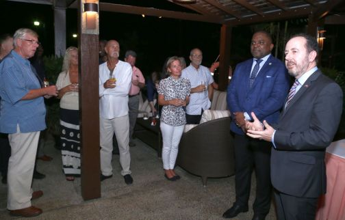 High Commissioner Tim Stew speaks to guests at the reception as Deputy Chief Secretary Joel Jack stands next to him.