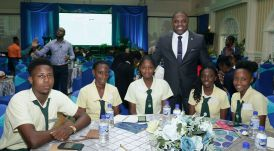 Secretary of Finance and the Economy Joel Jack with sixth form pupils of the Signal Hill Secondary school at the Conference.