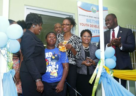 Centre manager Janice McMillan cuts the ribbon to formally reopen the Bethel Youth Centre.