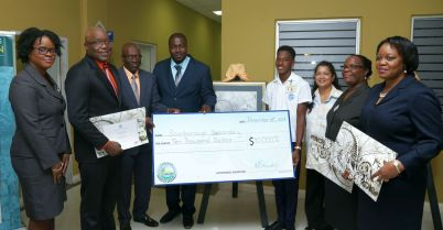 Unit Trust Corporation Manager Ijeoma Degale-Harry, THA Chief Secretary Kelvin Charles, Chief Administrator Raye Sandy, Secretary of the Division of Settlements, Urban Renewal and Public Utilities Clarence Jacob, winner Shakir James, Scarborough Secondary School art teacher Jeanine Crouch, Principal of the Scarborough Secondary School Althea Alexander, Administrator of the Division of Finance and the Economy Claire Davidson-Williams pose for a group photo. Art competition winner James holds the $10, 000 cheque awarded to Scarborough Secondary School.