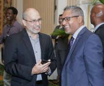 Trinidad and Tobago Chamber of Industry and Commerce Chief Executive Gabriel Faria and Agriculture Minister Clarence Rambharat.