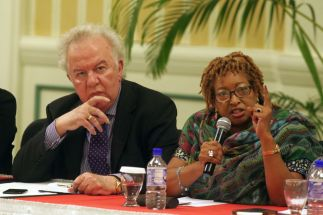 Chairman of the Tobago Hotel and Tourism Association Chris James listens as Vice President of the Tobago Hotel and Tourism Association Carol Ann Birchwood-James speaks on tourism.