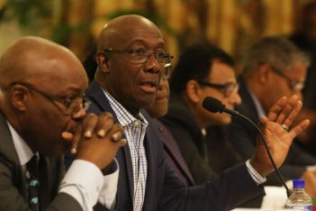 Chief Secretary Kelvin Charles listens as Prime Minister Dr Keith Rowley speaks during the meeting.