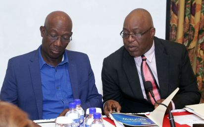 Chief Secretary Kelvin Charles, right, talks with Prime Minister Dr Keith Rowley during the meeting.
