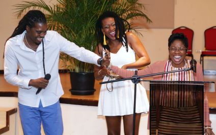 """Author Nichola Harvey-Mitchell, right, shares a moment with guest artistes Joel """"Positive"""" Murray and Stephanie Joseph."""
