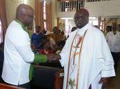 THA Chief Secretary greets Bishop Claude Berkeley.