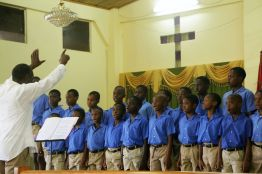 "Hope Anglican Primary school boys' choir sing the test piece Kum Ba Yah (""Come by Here"") to place second in the schools choir (15yrs and under)."