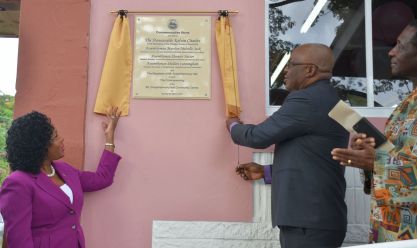 Chief Secretary Kelvin Charles and Secretary of Community Development, Enterprise Development and labour Marslyn Meville-Jack unveil the plaque to mark the recommissioning of the Mt Grace Community Centre on Monday (March 5, 2018). At right is Reverend Rawle Baird.