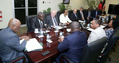 Representatives from the THA and the Trinidad and Tobago Chamber of Commerce sit during the meeting.
