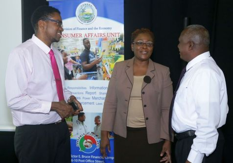 From left, Langdon Phillips- Manager of the Consumer Affairs Unit -Division of Finance and the Economy, Denese Toby-Quashie- Administrator of the Division of Finance and Rey Marslier - Academy of Auto Mechanics representative.