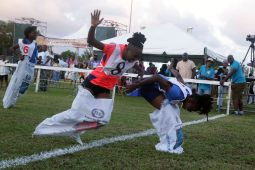 The female sack race is won by Amira John with Jahmilia Edwards in second and Ayla Stanisclaus third.