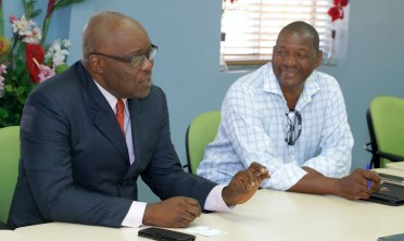 Chief Secretary Kelvin Charles makes a point during the meeting.