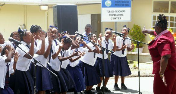 Students of the Scarborough Methodist School choir perform a folk song.