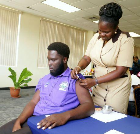 Nurse Latoya McKenzie administers a vaccine during the Health Fair.