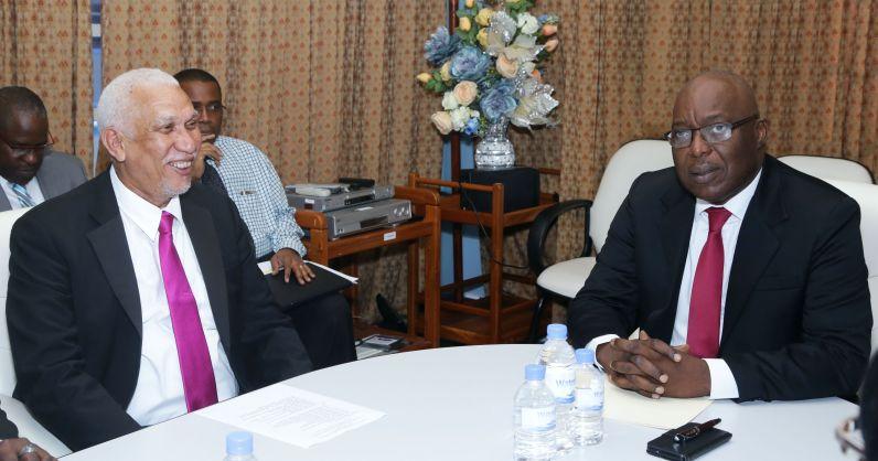 UDeCOTT chairman Noel Garcia, left, and THA Chief Secretary Kelvin Charles.