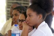 Visiting students pay close attention during Solomon's address.
